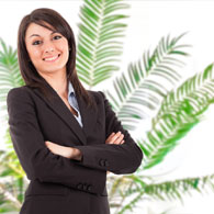 Corporate Woman with Palm Plant