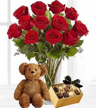 The Ultimate Valentine's Gift - Twelve Vased Red Roses with Chocolates & Bear